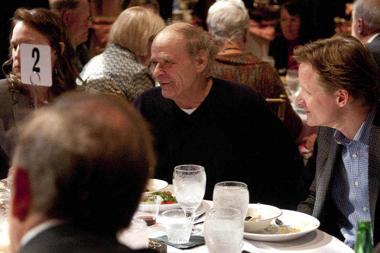 Pulitzer Prize-finalist author Tim O\'Brien talks with fellow dinner guests at VonnegutFest\'s Timequake Clambake at Indiana Landmarks\' Cook Theater, Saturday, Nov. 9, 2013.